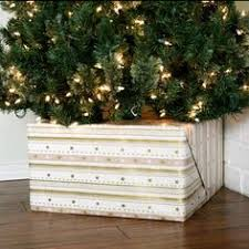 hide your tree base with a gift tree base