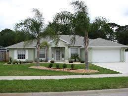 attractive cream and gray house exterior paint idea with garage