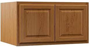 medium brown oak kitchen cabinets hton bay hton assembled 36x18x24 in above refrigerator wall bridge kitchen cabinet in medium oak