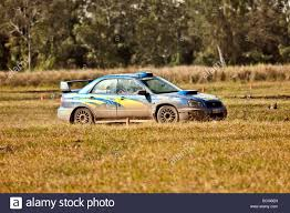 subaru rally wrx subaru wrx rally car doing circuits on a dirt track stock photo