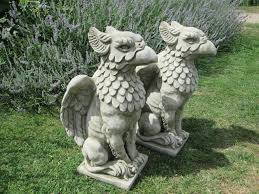 pair of concrete griffin eagle garden ornaments statues in