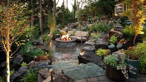 Stone Patio With Fire Pit Lush Garden And Gray Stone Patio Alderwood Landscaping Hgtv