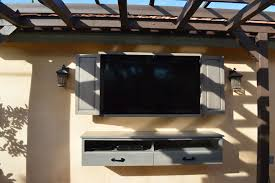 modest light grey wooden outdoor tv mount with door and floating console table jpg