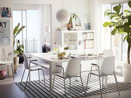 dining room furniture ideas ikea a light dining room furnished with a large white table and four white chairs with chrome
