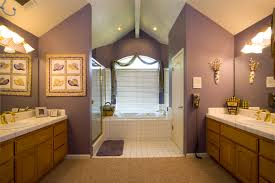 large bathroom design idea with catchy purple wall and completed