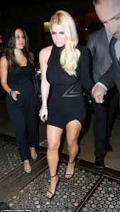 jessica simpson pours her curves into little black dress with eric