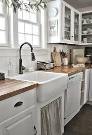 white kitchen cabinets with farm sink farmhouse sink white kitchen cabinets wood flooring rustic