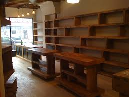wood shelving up the wall pos counter reclaimed wood top store