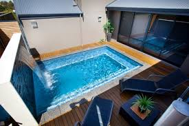 Small Pools For Small Backyards by Small Blue Angular Indoor Swimming Pool With Profuse Houseplants