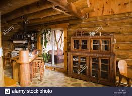 kitchen room area with buffet inside a rustic cottage style stock