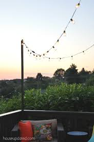 post to hang string lights diy posts for hanging outdoor string lights house updated
