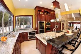 granite countertop kitchens painted orange faux stone backsplash
