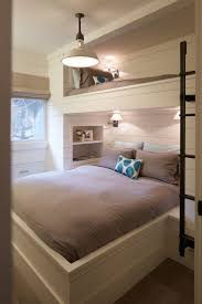 25 best upstairs bedroom ideas on pinterest house eaves attic fantastic kids room with built in bunk over queen sized bed layered with taupe bed linens accented by blue ikat dot pillows flanked by a recessed bookshelf