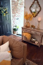 how to decorate an accent table welcome your guests with a festive fall entry use a small accent