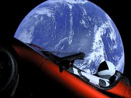 this is a real photo of a tesla sports car flying through space
