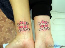 rosy skulls with crossed bones and pink bows wrist