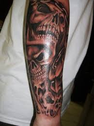 evil skull sleeve tattoos design pictures