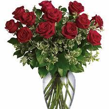 one dozen roses one dozen roses elegantly presented in this vase