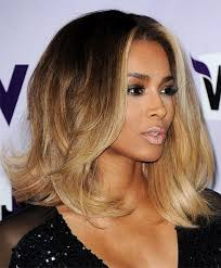 feathered mid length hairstyles black women feathered hairstyles women medium haircut