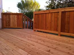 stained cedar deck with fenced railing deck railings railing