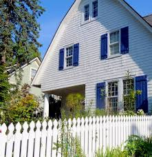 white house with blue trim landscaping and entryways pinterest