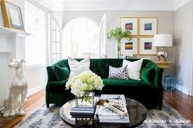 emerald green velvet sofa with black coffee table transitional
