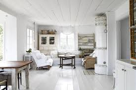 a traditional red and white farmhouse in sweden
