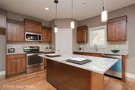 white kitchen cabinets with river white granite river white granite countertops pictures cost pros cons