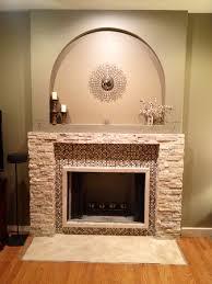 photos hgtv custom black fireplace with textured tile surround