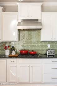 painted kitchen cabinet ideas and makeover reveal the green glass tile backsplash before and after photos kitchen that had cabinets