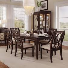 elegant dining room with neutral fabrics and dark wood igf usa