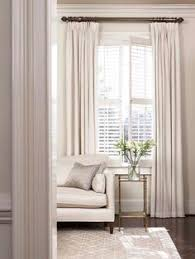 white plantation shutters and built in window seats our dream