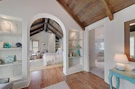 cottage master bedroom ideas traditional master bedroom with built in bookshelf cathedral