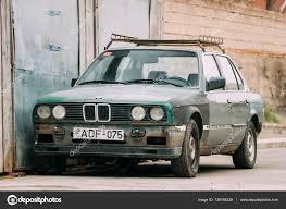 cars bmw 2016 old rusty sedan car bmw 3 series e30 parking on street the bmw