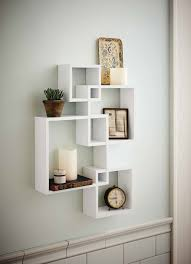 shelving solution intersecting decorative white color wall shelf