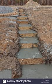 newly poured concrete setup for house footings stock photo