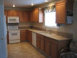 backsplash ideas for small kitchens beige tile backsplash and granite countertops added by brown