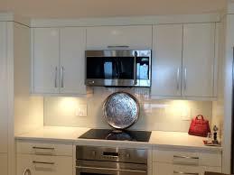 small white kitchen decoration using white wood kitchen cabinet