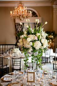 tall white wedding centerpiece justin demutiis photography