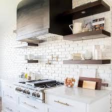 sconces above kitchen floating shelves design ideas