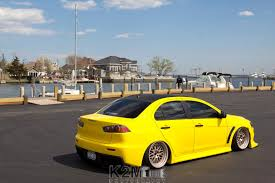 mitsubishi yellow car mitsubishi lancer evo x yellow cars wallpapers hd desktop