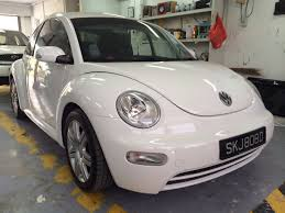 volkswagen singapore white vw beetle with auspicious