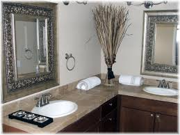 rectangle black wooden mirror frames on the wall and beige tile