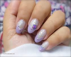 lilac nail polish design cute butterfly on glitter background
