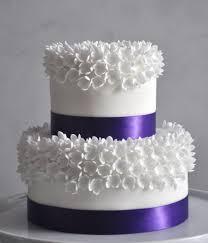 white stephanotis wedding cake la floreta by lori anne skawinski