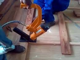 nailing solid wood floor boards with a floor nailer