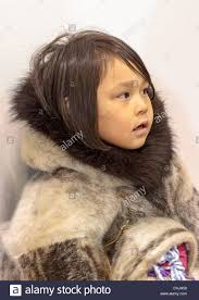 young inuit in traditional skin clothing grise fjord