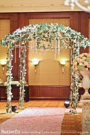 wedding arch leaves wedding arch with flowers butterfly event styling