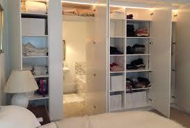 great looking bedroom design with hidden door bathroom behind