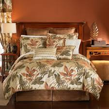 leaf pattern white tropical bedding sets with brown wooden bed
